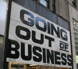 "Sign that reads ""going out of business."""