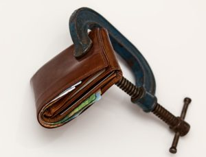 Photo of a wallet in a clamp.