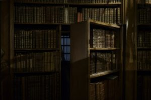 Image of a secret room behind a wall of books.