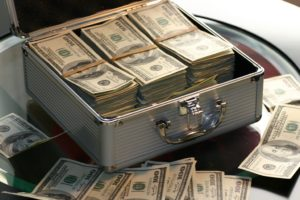 A briefcase full of money to represent when lawyers steal client funds.