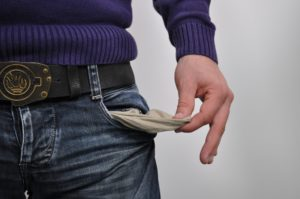 Photo of empty pockets to represent that you can't pay debt collection.