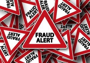 Signs that say fraud alert to represent a debt collection scam.
