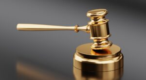 gold gavel to represent default judgment interest