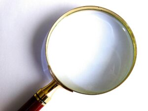Magnifying glass to represent debt collection attorney licensed.